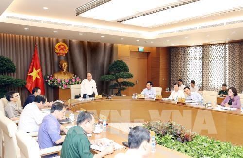 Le PM Nguyen Xuan Phuc preside une reunion sur la preparation du WEF-ASEAN hinh anh 1