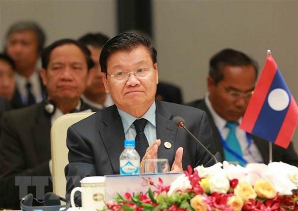 Le PM laotien assiste au FEM ASEAN 2018 au Vietnam hinh anh 1