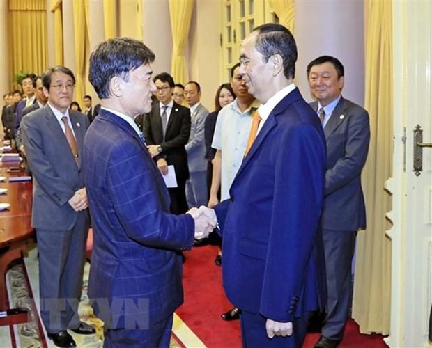 Le president Tran Dai Quang recoit le conseiller special du groupe japonais Mainichi hinh anh 1
