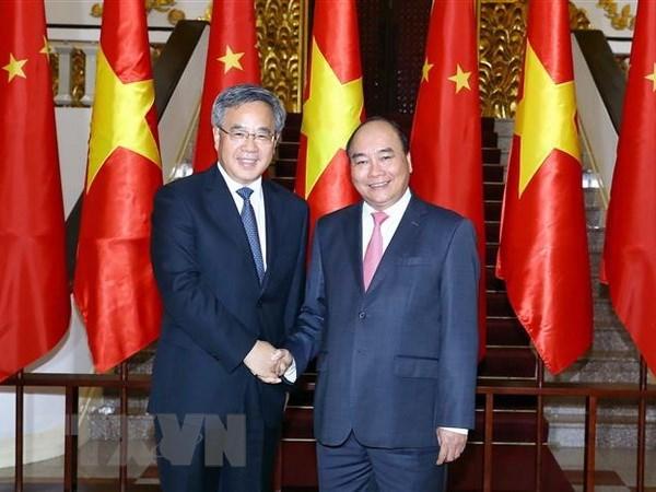 Le chef du gouvernement vietnamien recoit le vice-Premier ministre chinois Hu Chunhua hinh anh 1