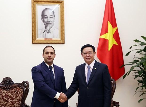 Le vice-PM Vuong Dinh Hue recoit le ministre bulgare de l'Economie hinh anh 1