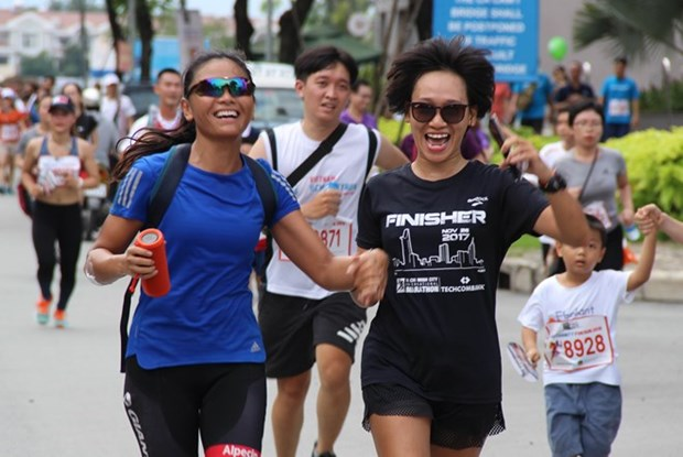 Plus de 10.000 personnes participent a la Fund Run for Charity a Ho Chi Minh-Ville hinh anh 1