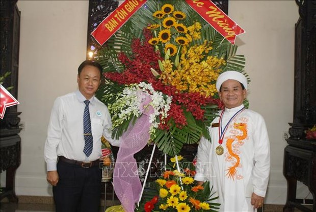 Ceremonie de celebration du 94e anniversaire de la fondation du caodaisme hinh anh 2