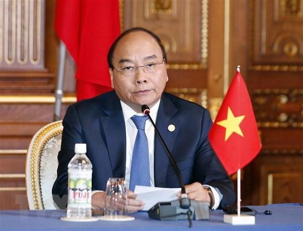 Le PM Nguyen Xuan Phuc a la conference de presse conjointe sur le 10eme sommet Mekong-Japon hinh anh 1