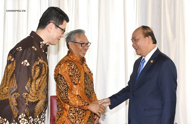 Le PM Nguyen Xuan Phuc rencontre des hommes d'affaires indonesiens hinh anh 1