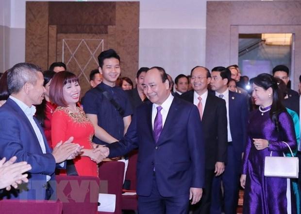Le PM Nguyen Xuan Phuc rencontre des Vietnamiens en Autriche hinh anh 1
