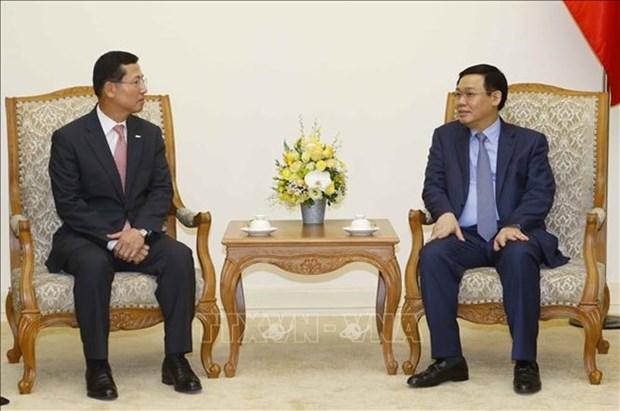 Le vice-PM Vuong Dinh Hue demande a Shinhan Card de developper la fintech au Vietnam hinh anh 1