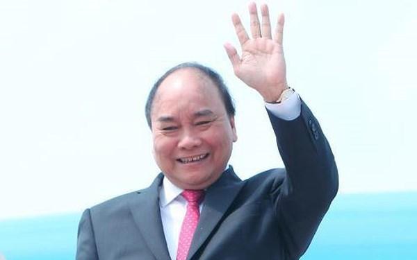 Le PM participe a la premiere Foire internationale des importations de Chine hinh anh 1