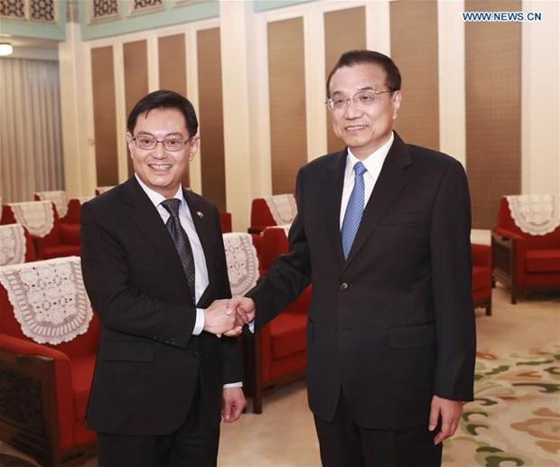 La Chine collaborera avec Singapour pour proteger le systeme commercial multilateral hinh anh 1