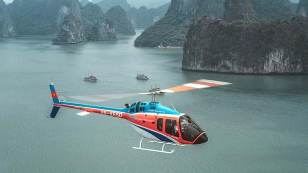 CNN Travel : Faire un vol en helicoptere au-dessus de la baie d'Ha Long est une nouvelle experience hinh anh 1