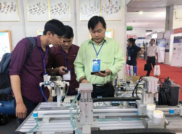 Ouverture d'une serie d'expositions sur l'electricite et l'imprimerie a Ho Chi Minh-Ville hinh anh 2