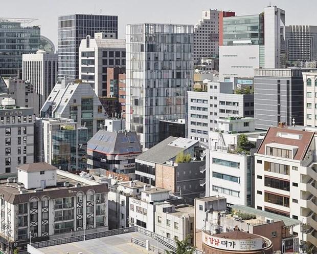L'exposition de photos sur le processus d'urbanisation de Seoul a Hanoi hinh anh 2