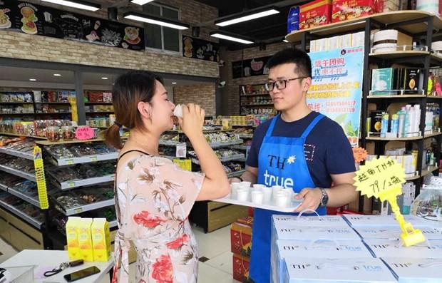 Premier lot de produits laitiers vietnamiens exporte vers la Chine hinh anh 1