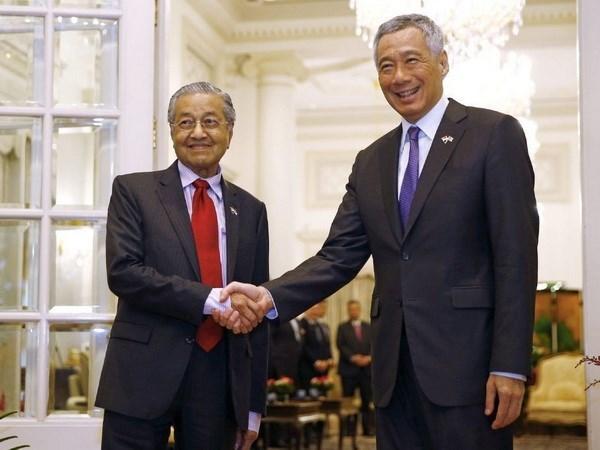 La Malaisie cherche a etablir un partenariat competitif avec Singapour hinh anh 1