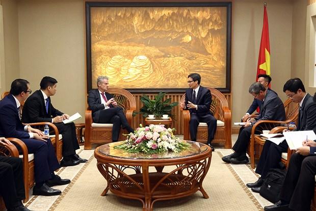 Le vice-PM Vu Duc Dam recoit le president de Microsoft d'Asie hinh anh 1