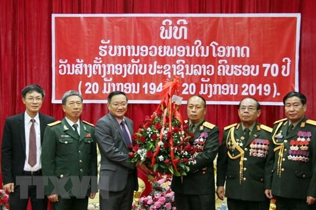 Activites celebrant des 70 ans de la fondation de l'Armee populaire du Laos hinh anh 2