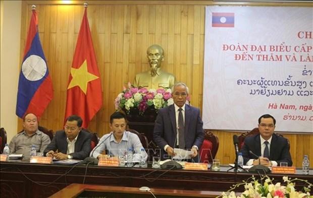 Promotion de la cooperation entre les localites vietnamienne et laotienne hinh anh 1
