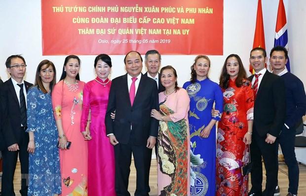 Le PM Nguyen Xuan Phuc rencontre la communaute vietnamienne en Norvege hinh anh 1