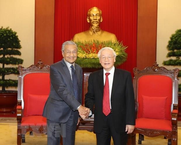 Le SG du Parti communiste et president du Vietnam recoit le PM malaisien hinh anh 1