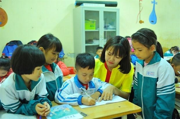 Les nouveaux manuels pour les eleves de premiere annee approuves hinh anh 1