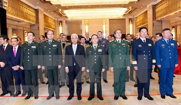 Commemoration du 75e anniversaire de la fondation de l'Armee populaire du Vietnam en Chine hinh anh 1