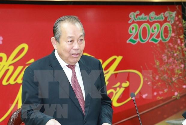 Le vice-PM Truong Hoa Binh rencontre la communaute vietnamienne en Suisse a l'occasion du Tet hinh anh 1
