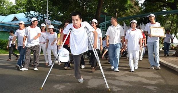 Des ONG participent a des activites de readaptation fonctionnelle pour les handicapes au Vietnam hinh anh 1