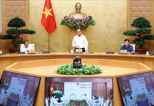 Le PM demande de redoubler de vigilance dans le combat contre le COVID-19 hinh anh 1
