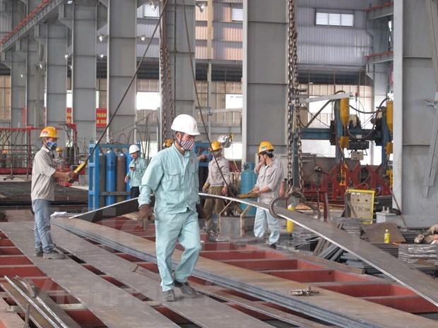 Les entreprises domestiques et etrangeres stimulent la production post COVID-19 hinh anh 1