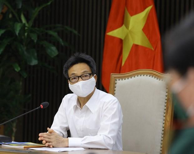 Le vice-PM Vu Duc Dam ordonne les actions plus drastiques contre le COVID-19 hinh anh 2
