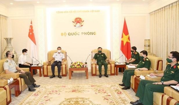 Le Vietnam cherche a cooperer avec Singapour sur la production de vaccins anti-COVID-19 hinh anh 1