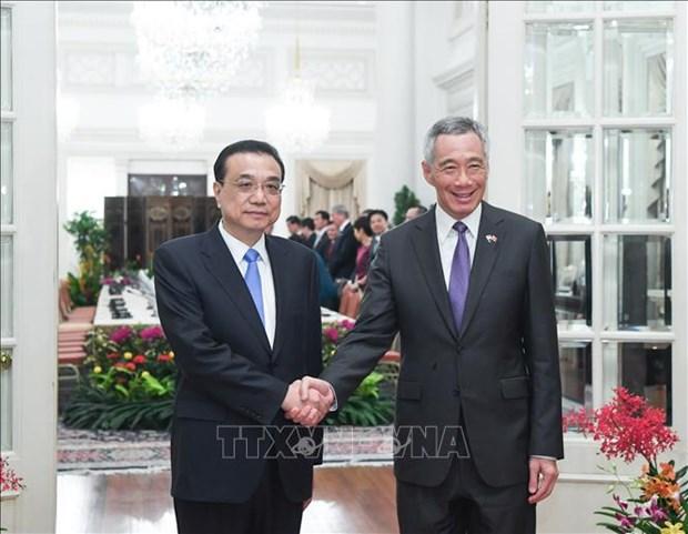 Singapour et la Chine s'engagent a travailler ensemble pour promouvoir les relations Chine-ASEAN hinh anh 1