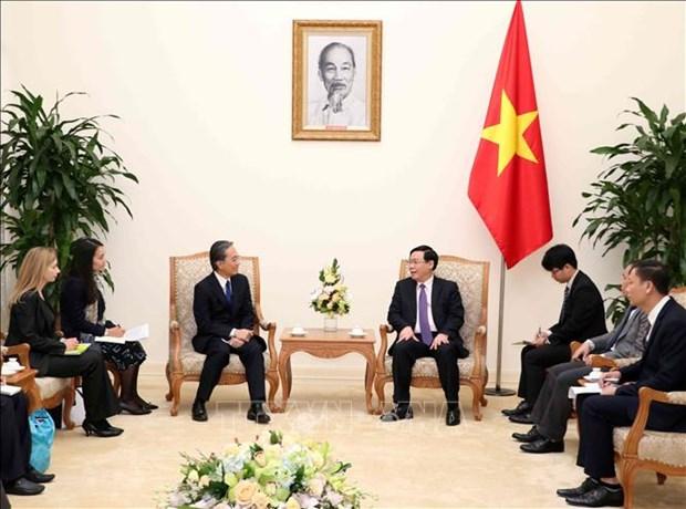 Le vice-PM Vuong Dinh Hue recoit le president de la societe japonaise de services financiers AEON hinh anh 1