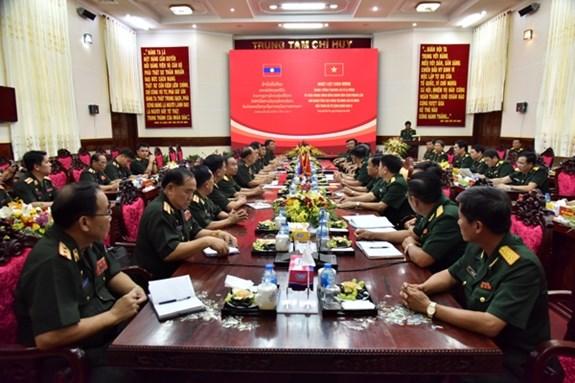 La delegation militaire laotienne se rend dans la 9e zone militaire hinh anh 1
