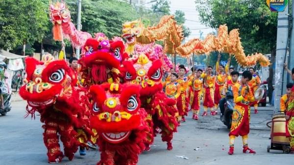 Developper la danse de la licorne, du lion et du dragon pour attirer les touristes hinh anh 1