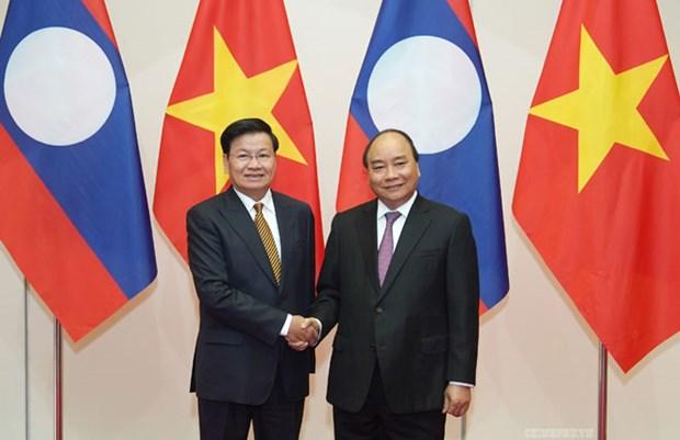 Vietnam et Laos sont determines a creer une percee dans le commerce bilateral hinh anh 1