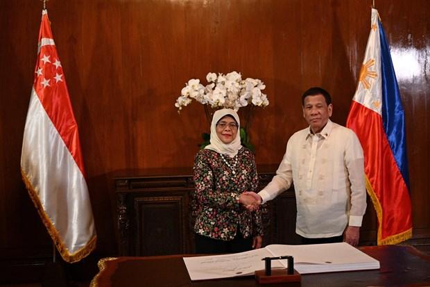 Renforcement de la cooperation dans la defense et l'economie Philippines - Singapour hinh anh 1
