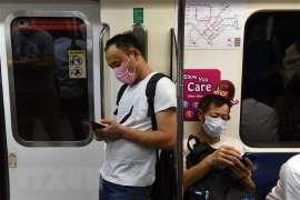 COVID-19: Singapour suspend ses activites de divertissement hinh anh 1