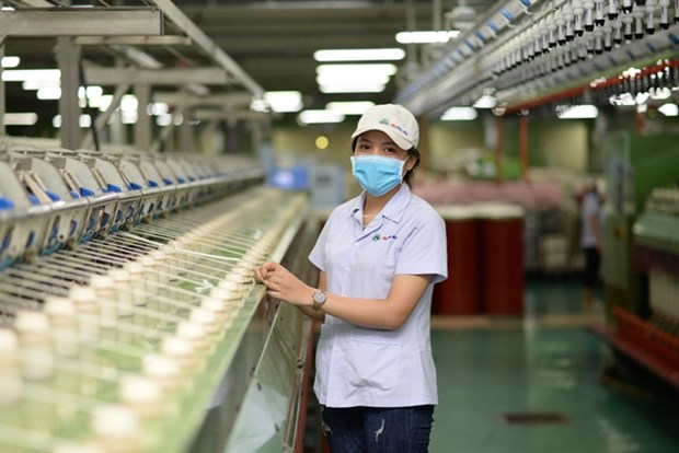 COVID-19 : L'industrie du textile-habillement cherche a s'adapter hinh anh 1