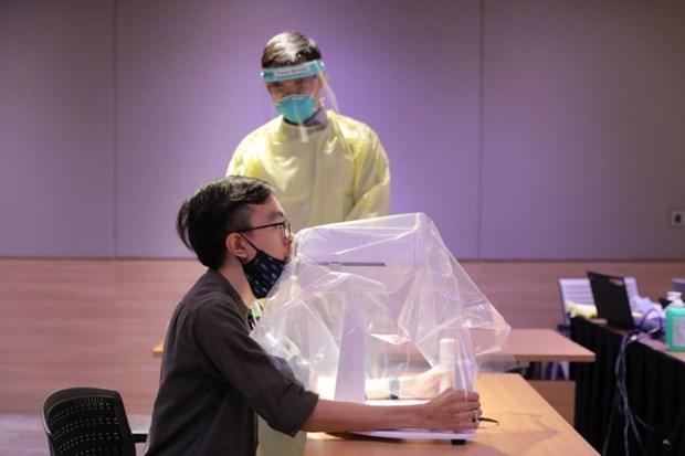 Singapour developpe avec succes un robot d'echantillonnage du COVID-19 hinh anh 1