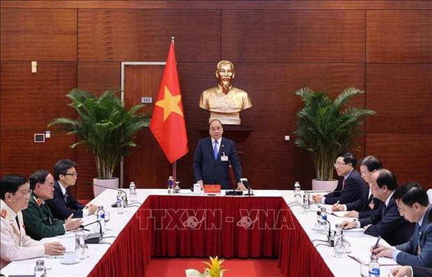 Le PM Nguyen Xuan Phuc: deployer des mesures fortes pour lutter contre l'epidemie de COVID-19 hinh anh 1
