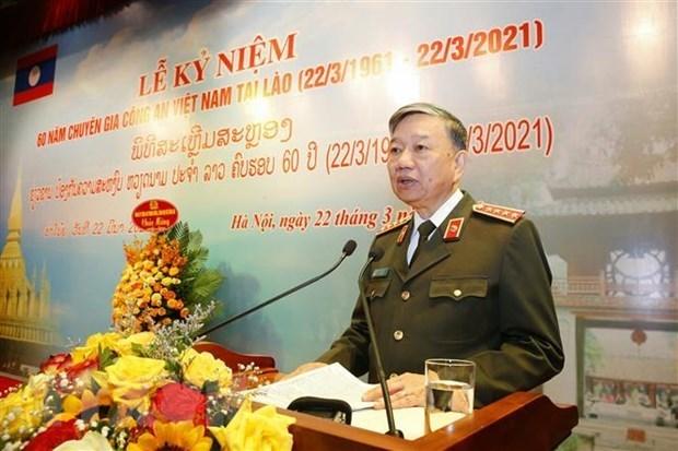 Ceremonie de celebration du 60e anniversaire de l'envoi d'experts de police vietnamienne au Laos hinh anh 1
