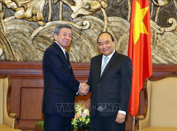 Le PM recoit le secretaire general p.i du Parti liberal-democrate du Japon hinh anh 1