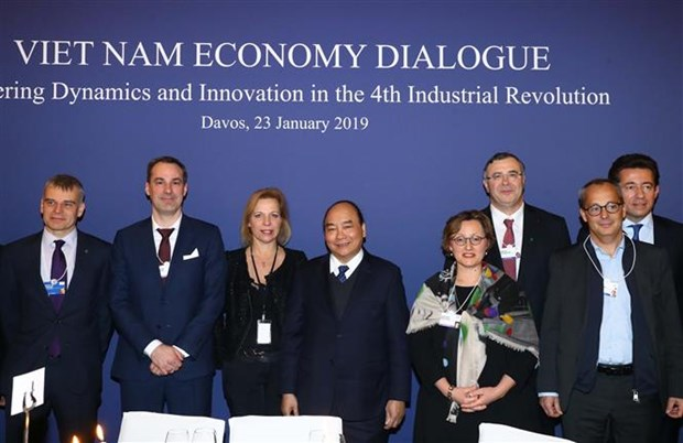 WEF 2019 : le PM dialogue avec des groupes multinationaux sur l'economie vietnamienne hinh anh 1
