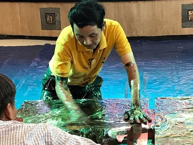 Un peintre vietnamien etablit un record mondial hinh anh 1