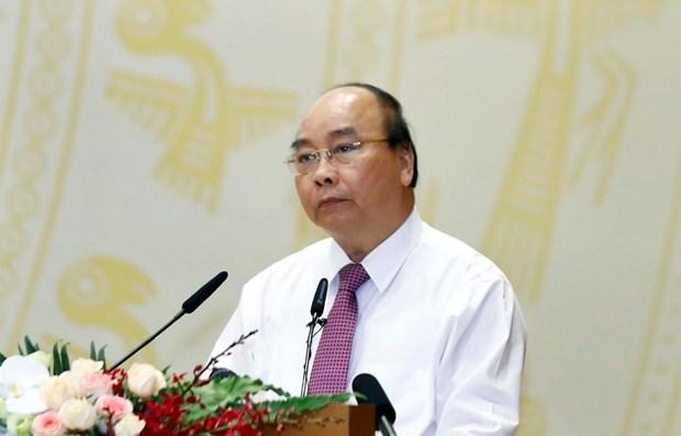 Le PM appelle a redoubler d'efforts pour atteindre les objectifs annuels hinh anh 1