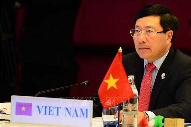 Le vice-PM Pham Binh Minh rencontre un haut representant de l'UE hinh anh 1