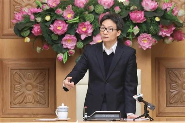 Le vice-PM Vu Duc Dam preside une reunion sur le COVID-19 hinh anh 1
