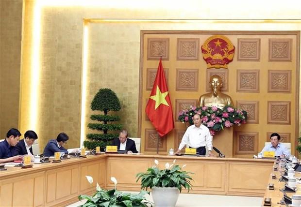 Le Premier ministre preside une reunion sur l'epidemie de COVID-19 hinh anh 1