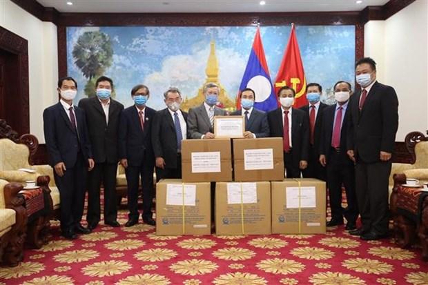 Remise de materiel medical au Laos, a l'Inde et aux armees de differents pays hinh anh 1